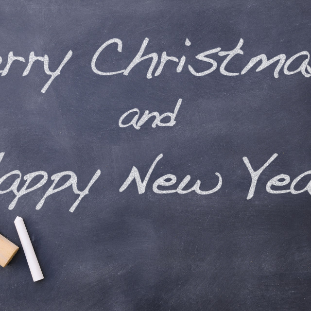 """Merry Christmas and Happy New Year on blackboard"" stock image"