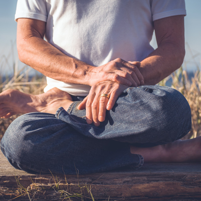 """Man sitting in yoga pose."" stock image"