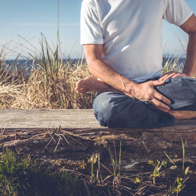 """""""Man sitting in yoga pose."""" stock image"""
