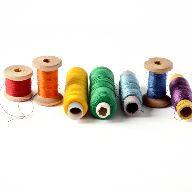 """Colorful thread bobbins"" stock image"