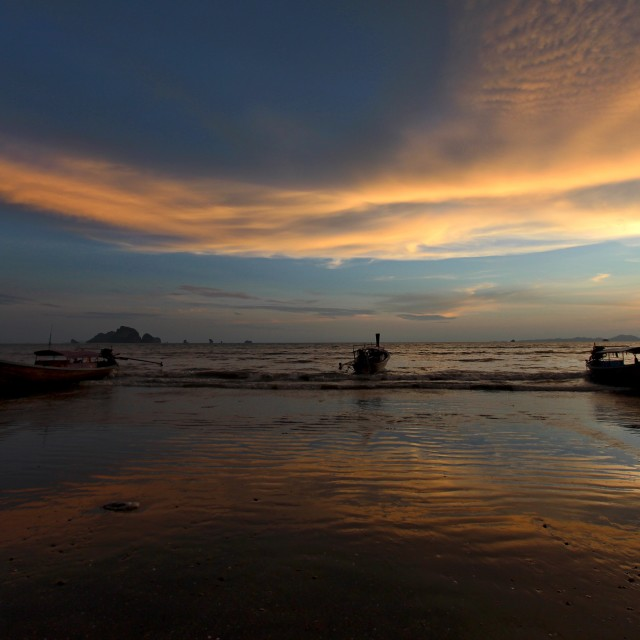 """""""Silhouettes of boats against sunset sky"""" stock image"""