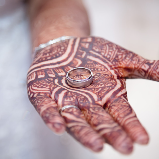 """Bride showing grooms ring"" stock image"