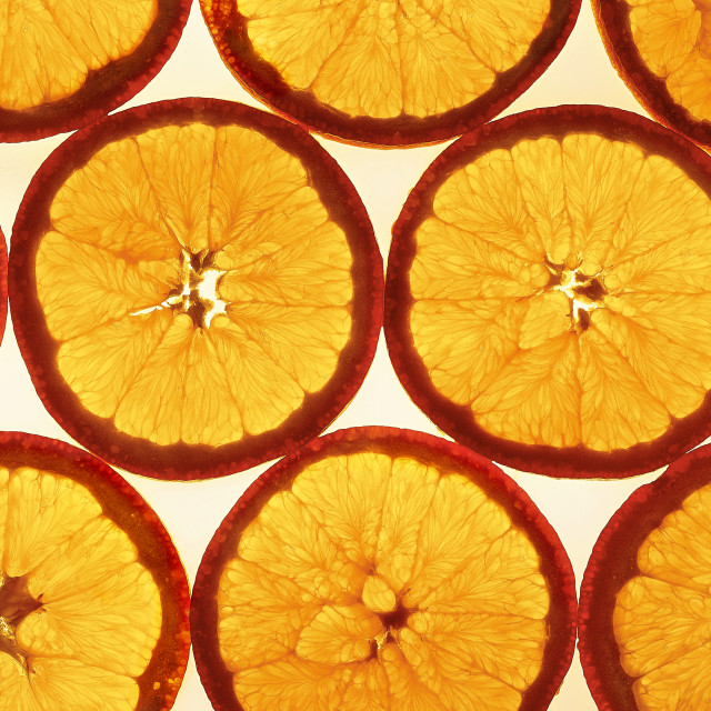 """Against the light orange slices pattern top"" stock image"