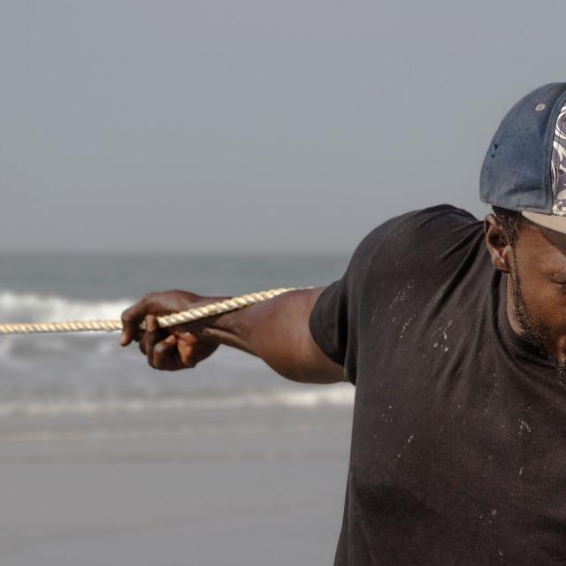 """Pulling A Fishing Net"" stock image"