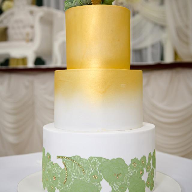 """Green Gold Wedding Cake"" stock image"
