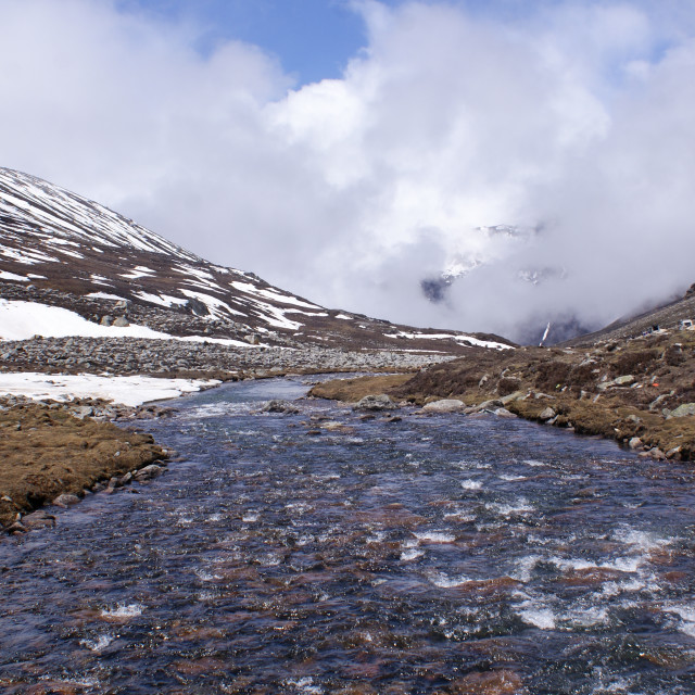 """""""Stream of crystal clear water at Zero Point, near Yumesamdong, North Sikkim"""" stock image"""