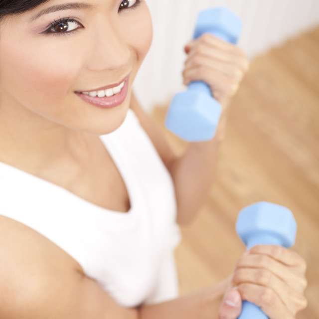"""""""Beautiful Young Asian Chinese Woman Lifting Weights At Gym"""" stock image"""