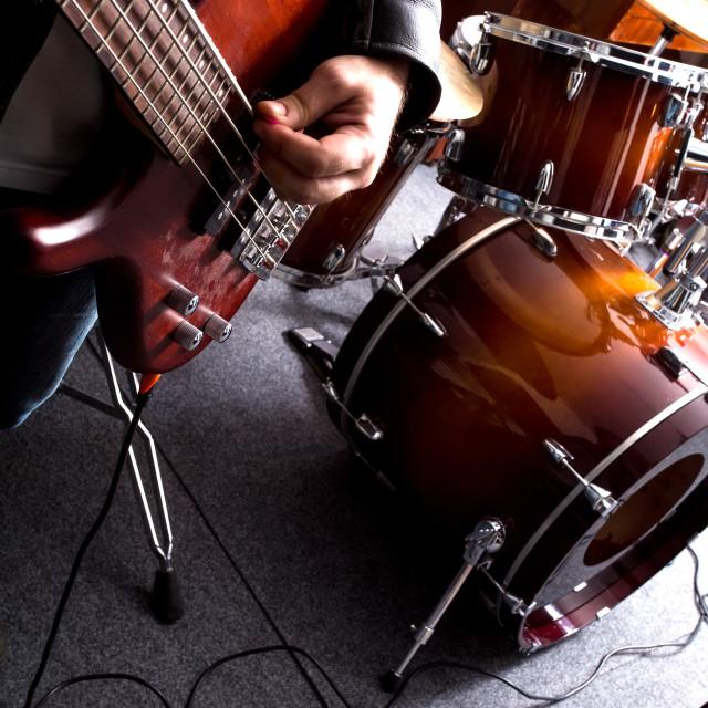"""Rock musician playing bass"" stock image"