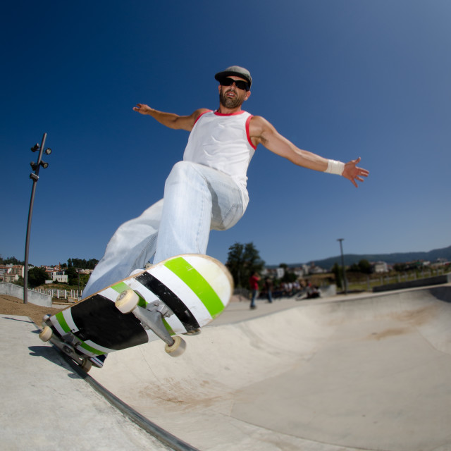 """""""Skateboarder in a concrete pool"""" stock image"""