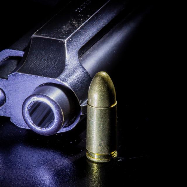 """Gun and bullets"" stock image"