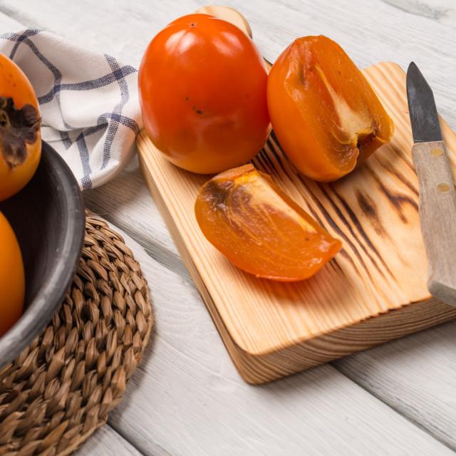 """Orange persimmons"" stock image"