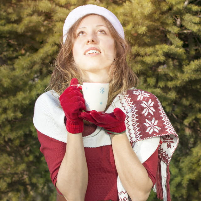 """Beautiful Santa Claus girl getting warm with hot beverage"" stock image"