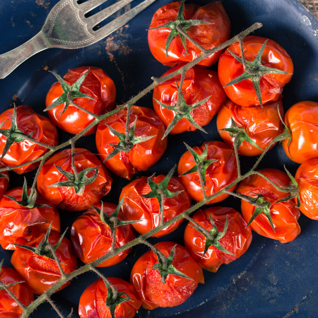 """Baked cherry tomatoes"" stock image"