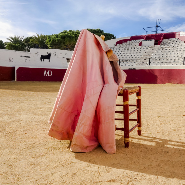 """Empty bullring with chair and Capote, cape."" stock image"