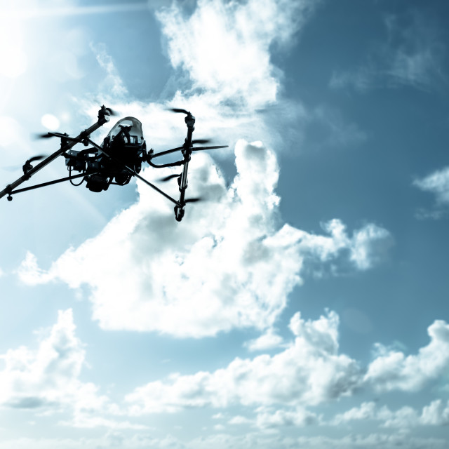 """Octarotor drone flying"" stock image"