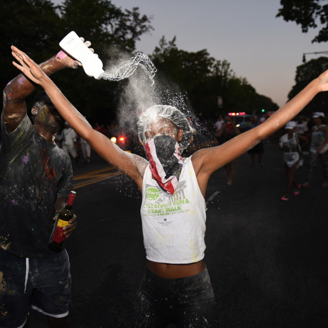 """Getting powdered at J'ouvert"" stock image"