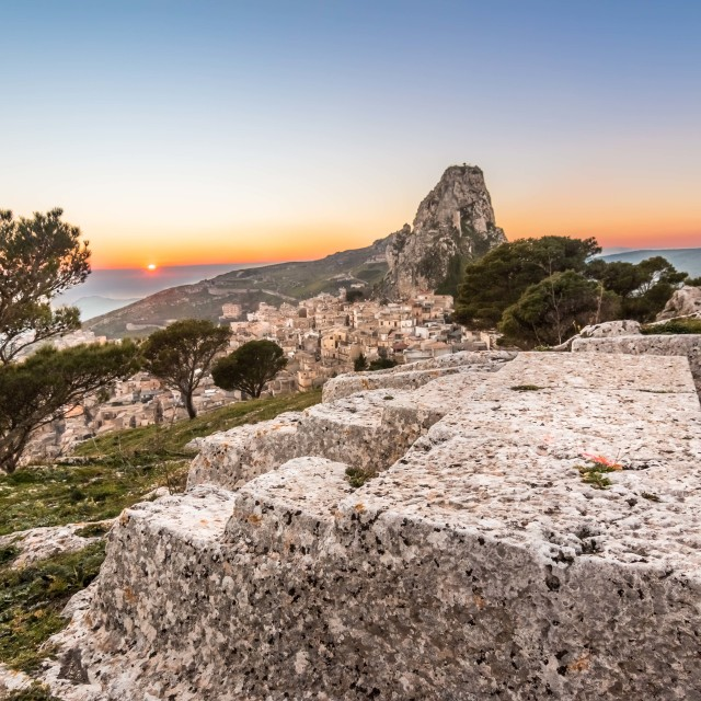 """Town on the mountain [Caltabellotta, Sicily] at sunset."" stock image"