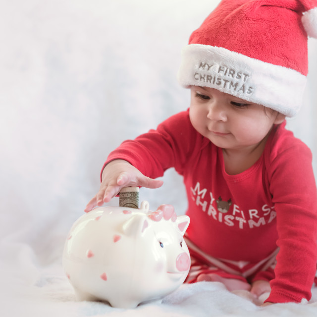 """Saving in Piggy Bank"" stock image"