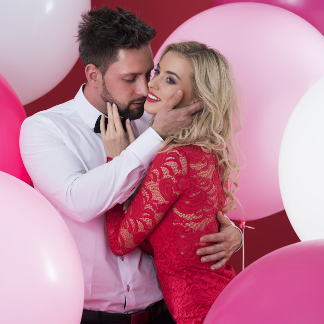 """""""Passionate embracement among the colorful balloons"""" stock image"""