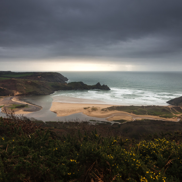 """Storm over Three Cliffs Bay Gower"" stock image"