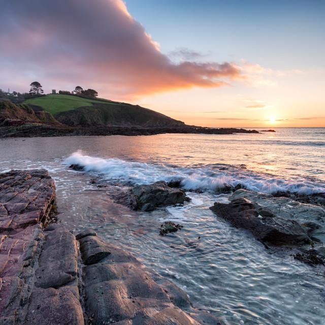 """Sunrise over Talland Bay in Cornwall"" stock image"