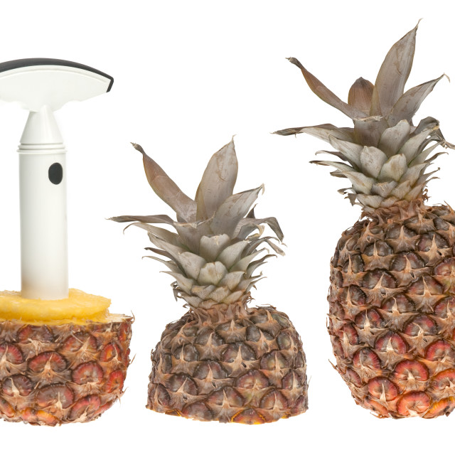"""Whole and split pineapple with cutter"" stock image"