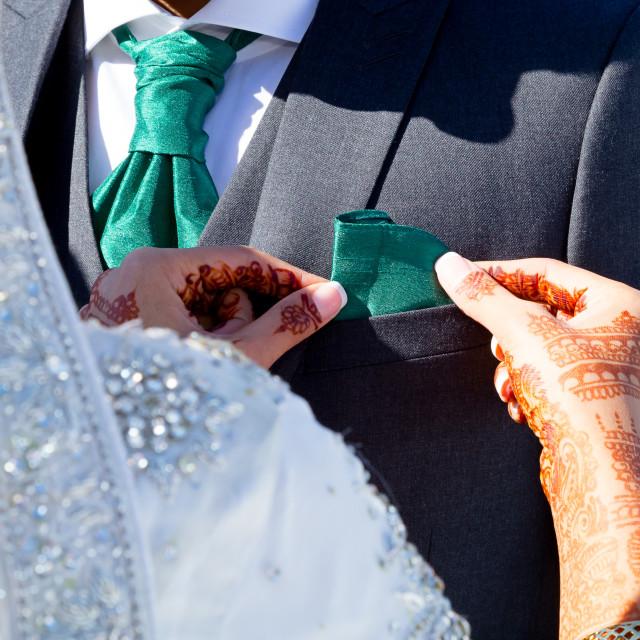 """Adjusting groom"" stock image"