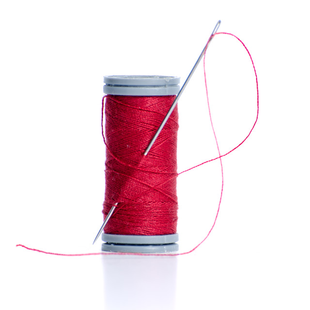 """Red thread bobbin and needle"" stock image"