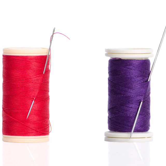 """Two red and purple thread bobbin and needle"" stock image"
