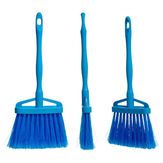 """Three plasticblue brooms"" stock image"