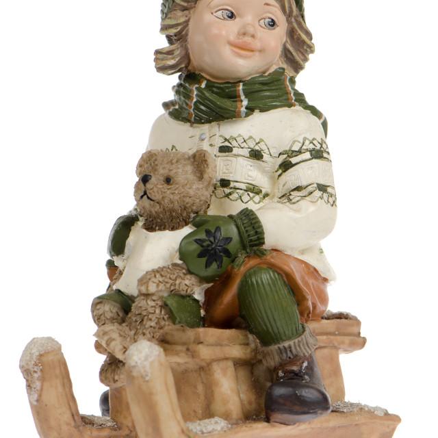 """Miniature of child on sleigh"" stock image"