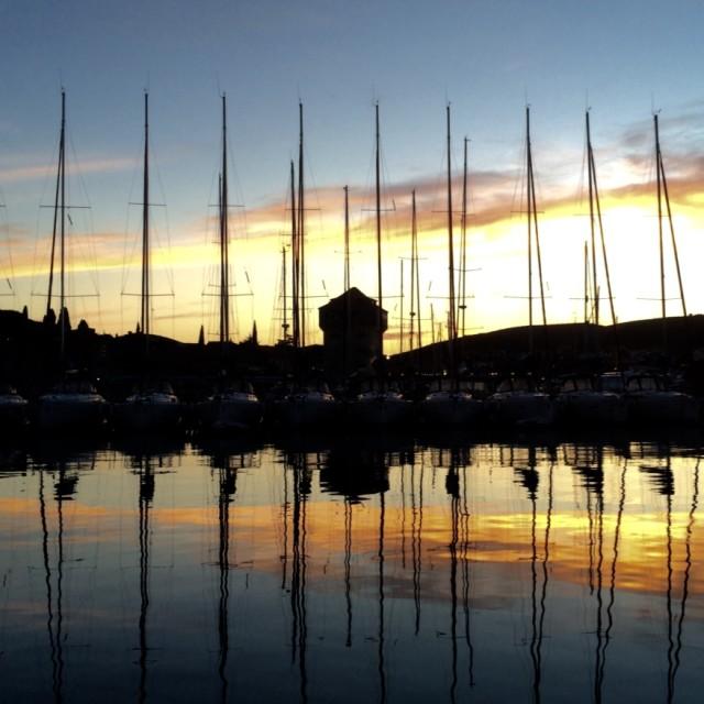 """Masts at Sunset"" stock image"