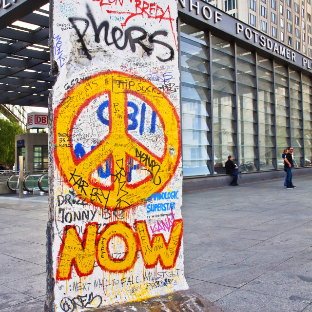 """Berlin wall section with graffiti on display at Potsdamer Platz"" stock image"