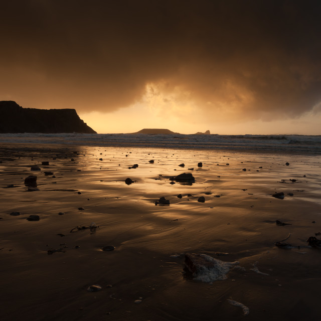 """Storm clouds at Worms Head"" stock image"