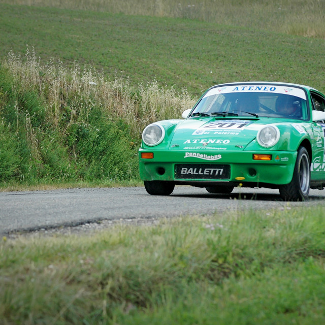 """Green vintage Porsche 911 S racing car"" stock image"
