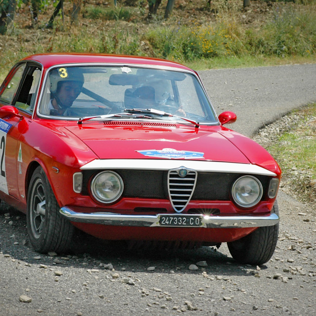 """Red vintage Alfa Romeo Giulia 105 racing car"" stock image"