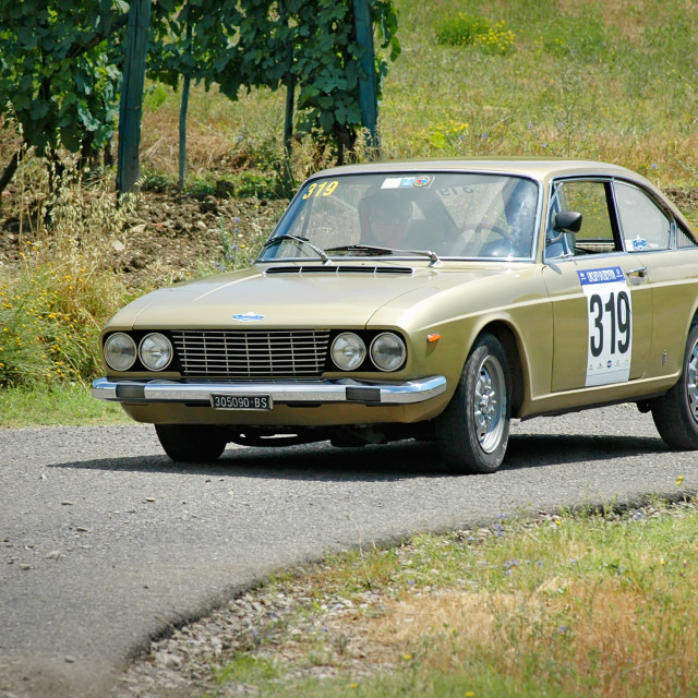 """Gold vintage Fiat 124 coupe racing car"" stock image"