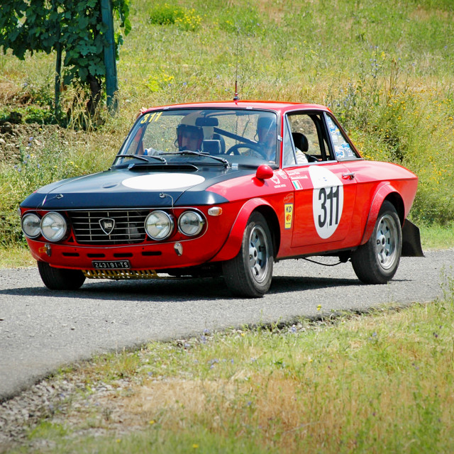 """Black and red vintage Lancia Fulvia racing car"" stock image"