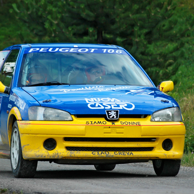 """Yellow and blue vintage Peugeot 106 racing car"" stock image"