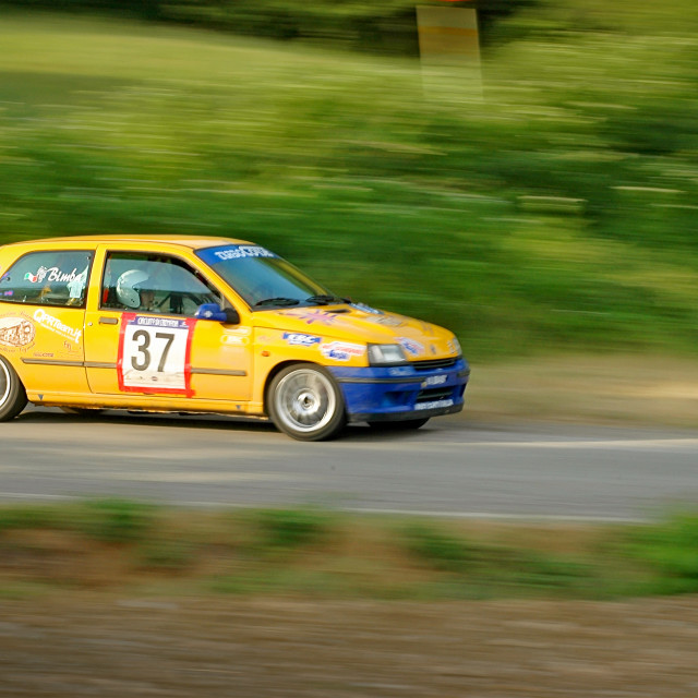 """Yellow vintage Renault Clio racing car"" stock image"
