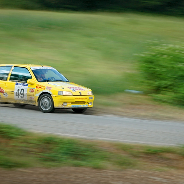 """Yellow vintage Peugeot 105 racing car"" stock image"