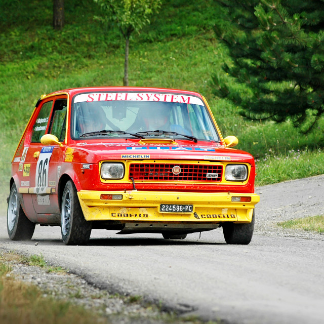 """Yellow and red vintage Fiat 127 racing car"" stock image"