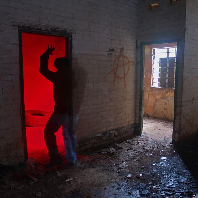 """Exploring a derelict building"" stock image"