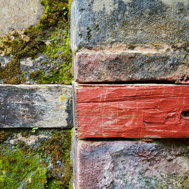 """Moss, brick and wood"" stock image"