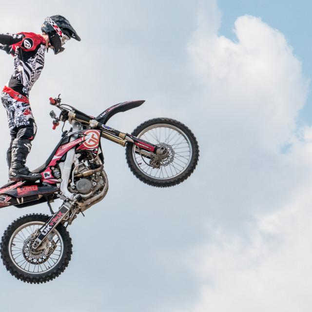 """""""Motorbiker standing"""" stock image"""