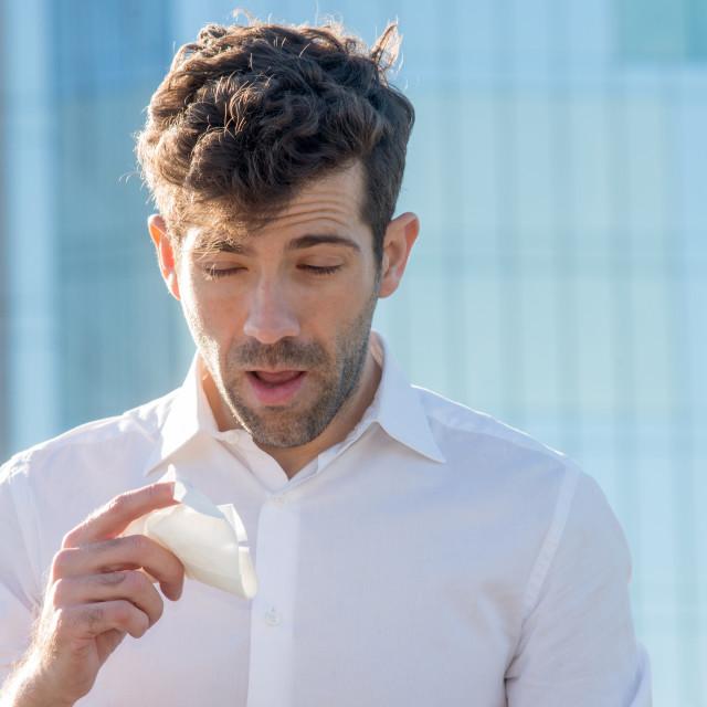 """Man with handkerchief sneezes"" stock image"