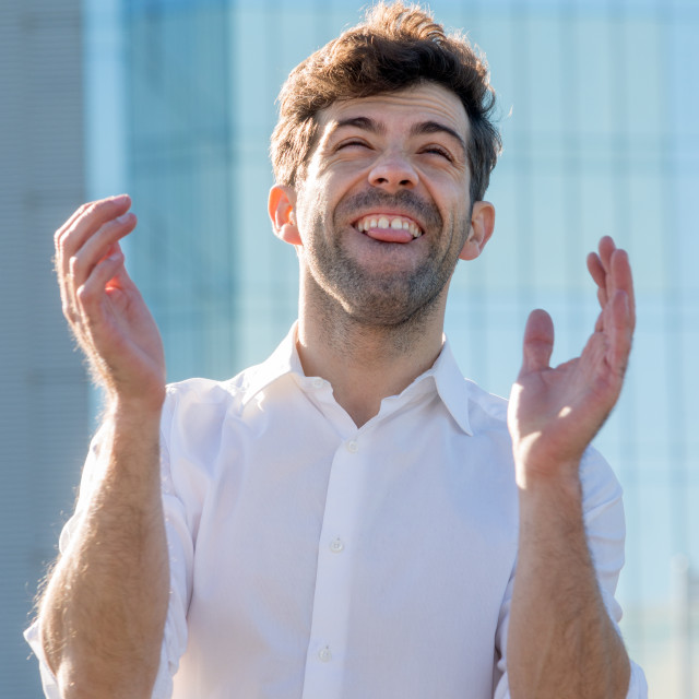 """Young Man celebrate winning aplause"" stock image"