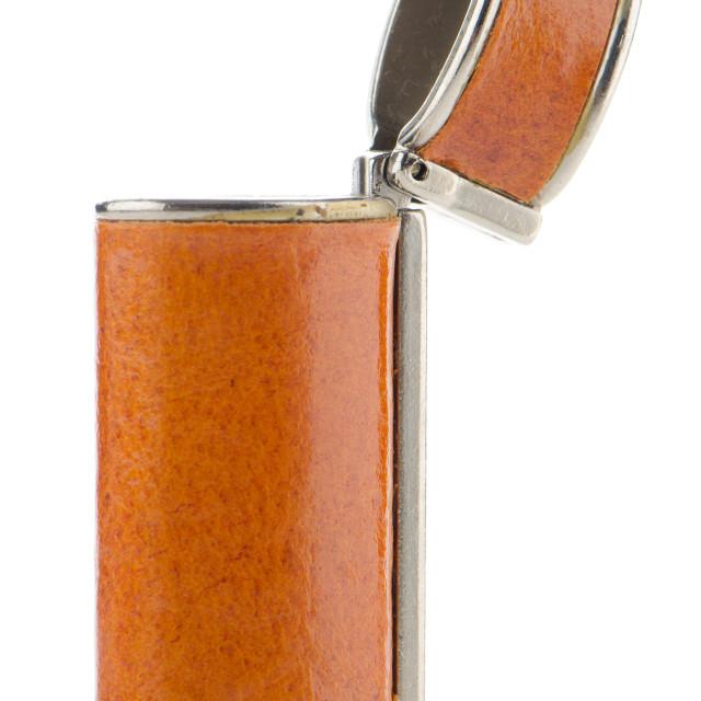 """Orange lighter case"" stock image"