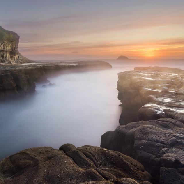 """Goldenhour dusk shot at a beach"" stock image"
