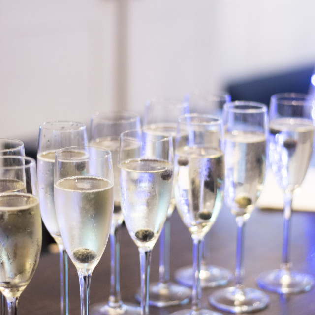 """Champagne white wine glasses in wedding party"" stock image"